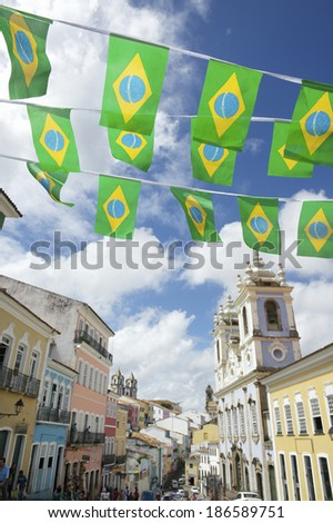 Brazilian flag bunting fluttering in bright afternoon sun over historic city center colonial architecture of Pelourinho Salvador da Bahia Brazil  - stock photo