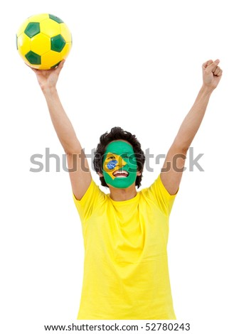 Brazilian football fan with the flag painted on his face - isolated over white - stock photo