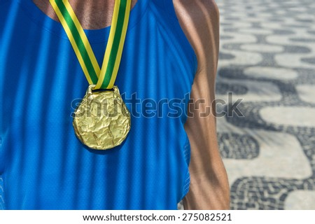 Brazilian gold medal first place athlete standing with palm frod shadows at the Ipanema Beach sidewalk in Rio de Janeiro Brazil - stock photo