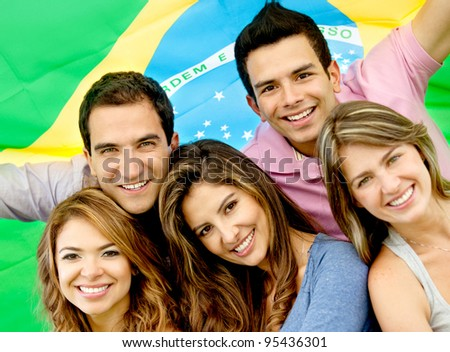 Brazilian group of people with the flag of Brazil - stock photo