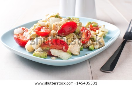 Brazilian hearts of palm salad with tomatoes and avocado - stock photo