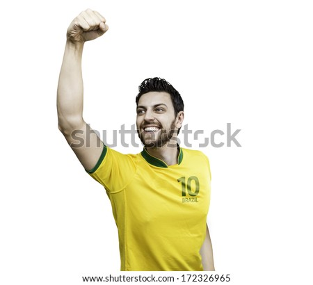 Brazilian man celebrates on white background - stock photo
