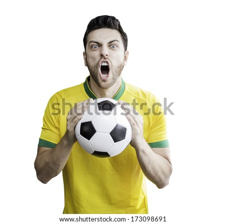 Brazilian man holding a soccer ball celebrates on white background. Can be used as Australian uniform too. - stock photo