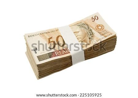 Brazilian money tied and piled - stock photo