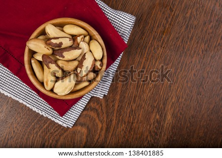 Brazilian nuts on a wooden table. - stock photo