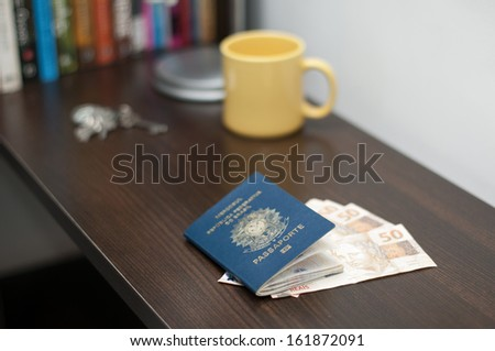 Brazilian passport and brazilian currency (Real) - stock photo