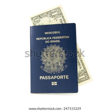 Brazilian passport with money - stock photo