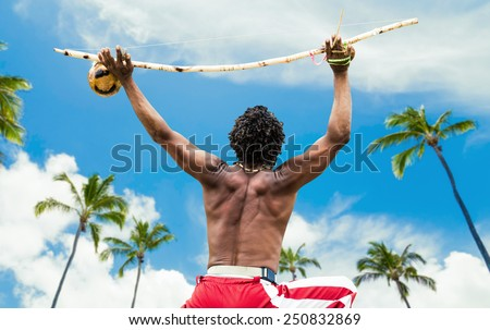 Brazilian performing Capoeira with Berimbau Instrument - stock photo
