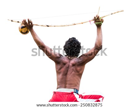 Brazilian performing Capoeira with Berimbau Instrument isolated on white background - stock photo