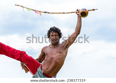 Brazilian playing Berimbau Instrument in Salvador, Bahia, Brazil. - stock photo