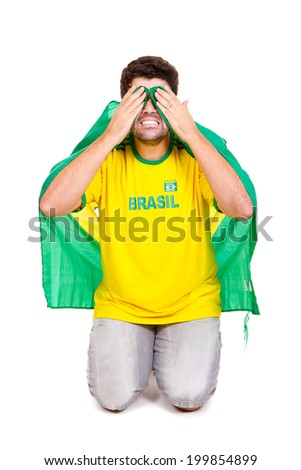 Brazilian soccer fan or supporter worried in the championship or competition or cup. - stock photo