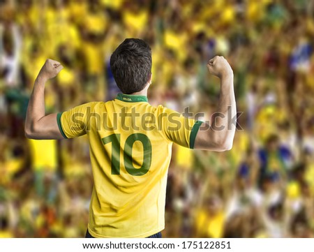 Brazilian soccer player celebrates with the fans - stock photo