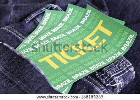 Brazilian soccer tickets on the jeans - stock photo