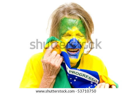 Brazilian sport fan holding a Brazilian Flag and Crying . - stock photo
