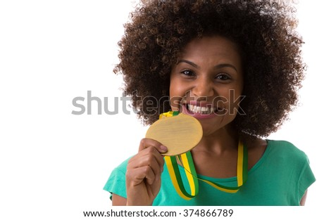 Brazilian woman holding a gold medal on white background - stock photo