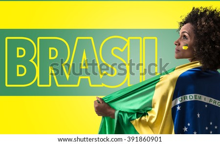 Brazilian woman holding the flag of Brasil and the Text: Brasil - stock photo