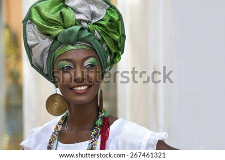 Brazilian woman of African descent, smiling, dressed in traditional Baiana attire in Pelourinho, Salvador, Bahia, Brazil. - stock photo