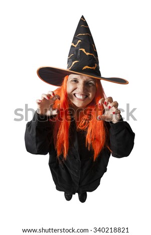 Brazilian woman wearing a Haloween costume - Witch casting spell on - isolated on white background. - stock photo