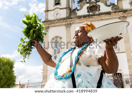 Brazilian woman wearing traditional clothes at Bonfim Church in Salvador, Bahia, Brazil