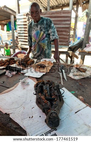 BRAZZAVILLE, REPUBLIC OF CONGO, AFRICA - SEPTEMBER 26, 2013: Smoked monkey  sold a local market. 26 september, 2013, Brazzaville, Republic of Congo, Africa.