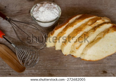 Bread and baking tools for preparation on wooden background - stock photo