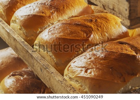 Bread and buns on shelf in bakery or baker's shop - stock photo