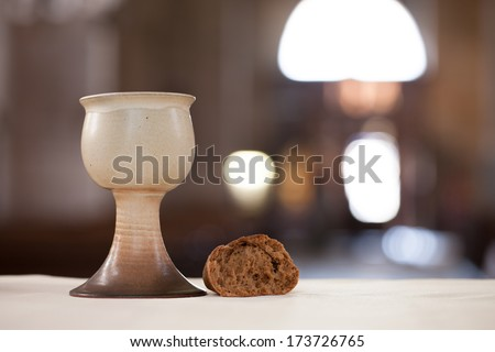 Bread and chalice with wine in the church. - stock photo