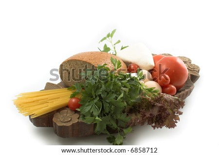Bread and cheese, fresh herbs, eggs and tomato - stock photo