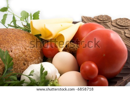 Bread and cheese, fresh herbs, eggs and tomato
