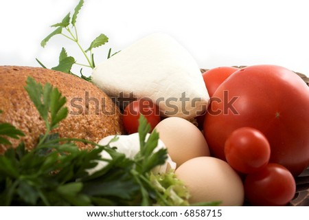 Bread and cheese, pasta, fresh herbs and tomato - stock photo