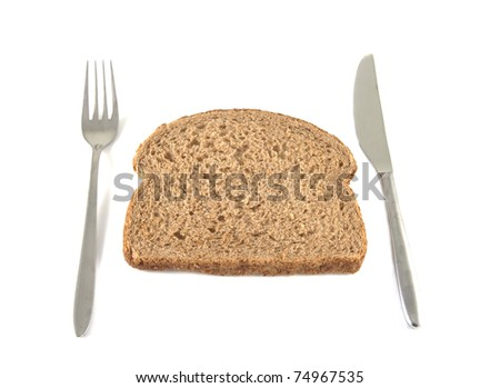 Bread and cutlery on a white background. - stock photo