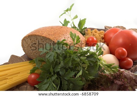 Bread and fresh herbs, pasta, eggs and tomato - stock photo