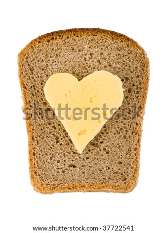 Bread and heart shaped cheese isolated on white background - stock photo