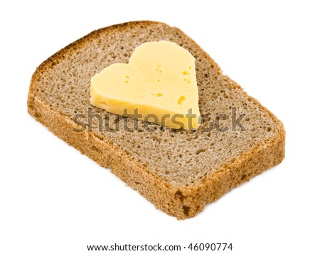 Bread and heart shaped cheese isolated on white background