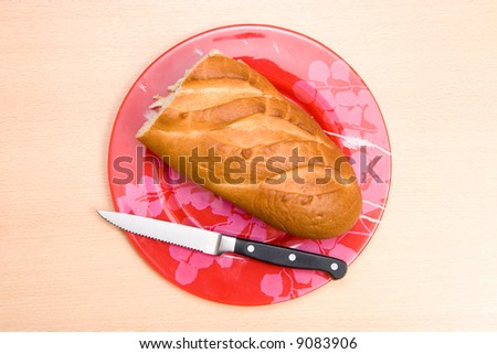 Bread and knife on a plate. - stock photo