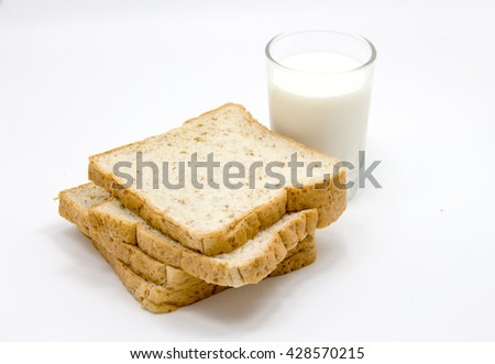 bread and milk for breakfast on white studio