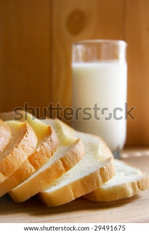bread and milk on wooden background