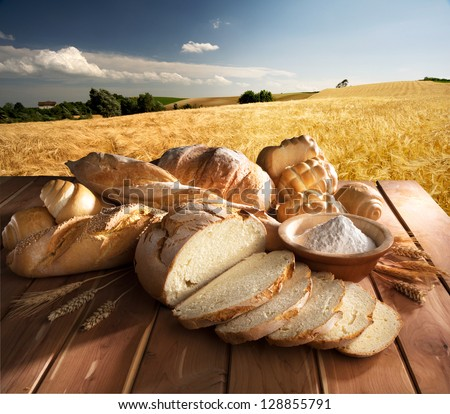 Bread and oil on the wooden table - stock photo
