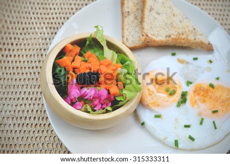 Bread and salad. Breakfast in vintage style  - stock photo