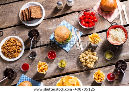 Bread and sauerkraut with burgers. Products and vegetables on table. Sign of hospitality. Vacation meal for every taste. - stock photo