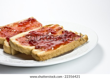 bread and strawberry marmalade on a plate
