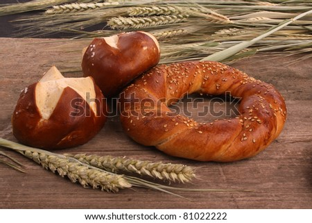 Bread and wheat on an old rustic wooden table