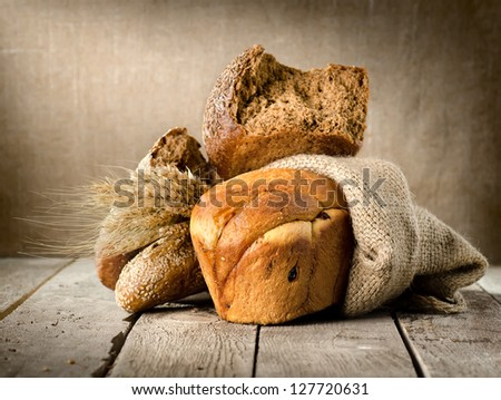 Bread assortment on background of the old canvas - stock photo