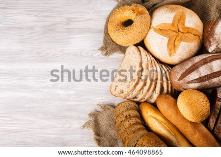 bread assortment on black grunge background