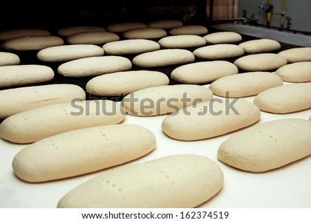 Bread bakery, factory with fresh food - stock photo