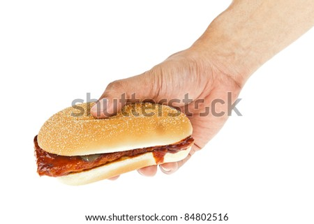 Bread, big sandwich hamburger and hand on white background - stock photo