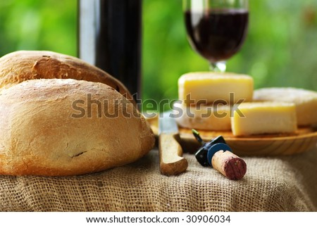 Bread, cheese and red wine. - stock photo