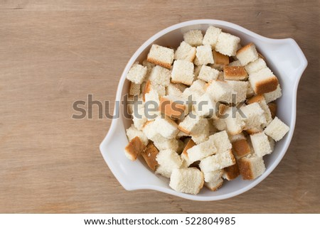 Bread cubes cut up in a bowl for making homemade stuffing.