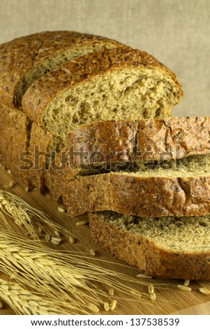 Bread cut on a blurry background (vertical) - stock photo
