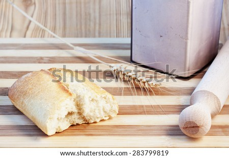 Bread, flour, wheat over chopping board, horizontal image - stock photo